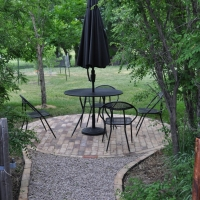 1702 Brick Lined Gravel Path to Circular Brick Patio