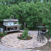 1707 Circular Brick Patio with Planter in Center