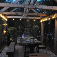 1715 Lighted Pergola and Table Area