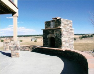 stone-fireplace-on-patio-300x238