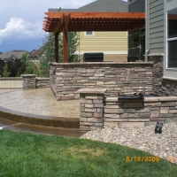 1508B - Stone Retaining Wall Outdoor Kitchen Pergola Patio